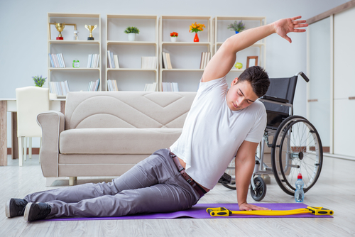 man exercising on floor of home