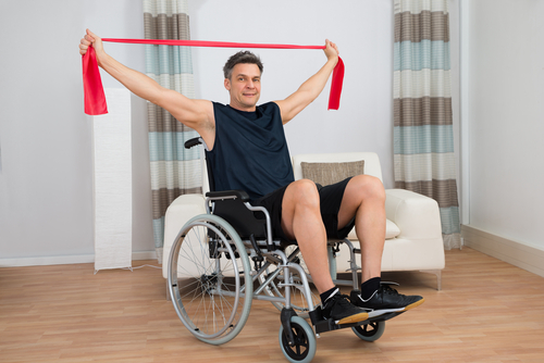 man in wheelchair training