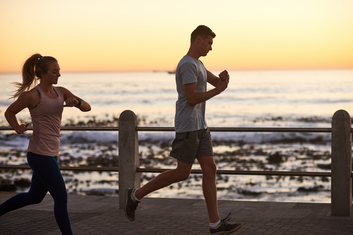 couple running with smartwatches