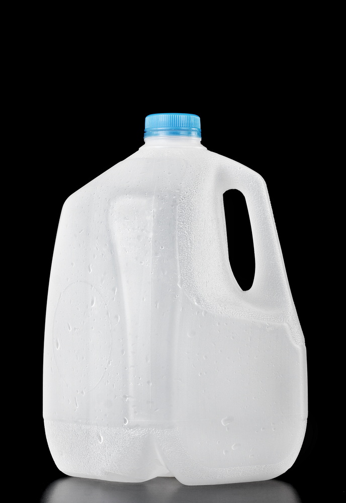gallon plastic water jug on black background How to Stay Hydrated