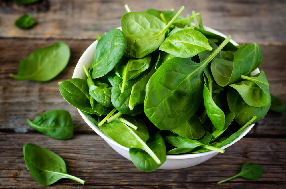 Bowl of raw baby spinach