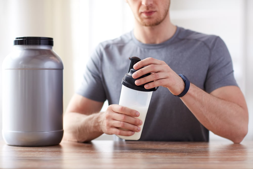 Man making Protein Shake before workout