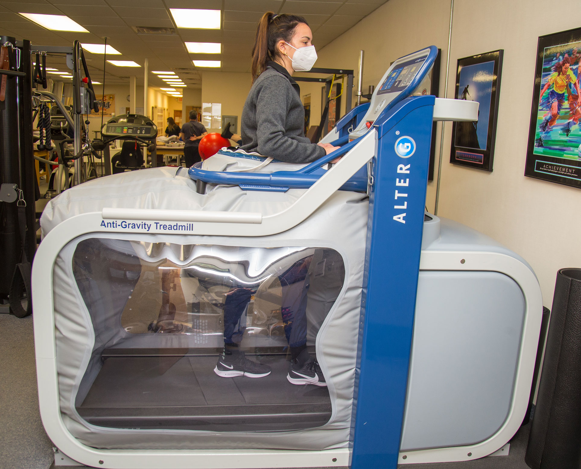 Patient using Alter G treadmill during treatment