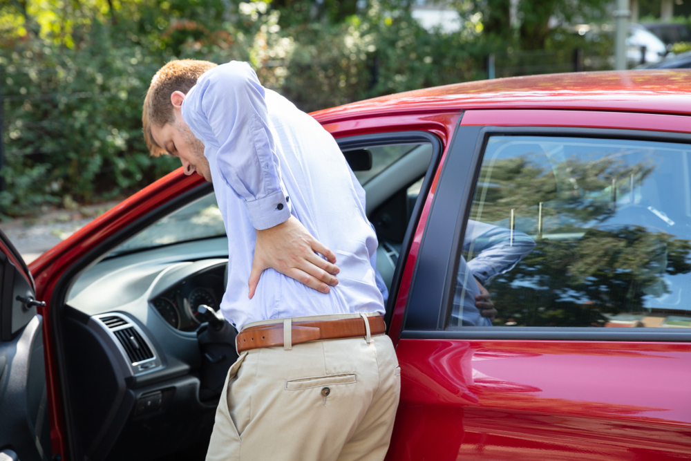 Driver Standing Having Backpain After Driving Car